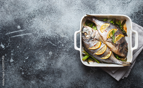 obraz lub plakat Fish dorado baked with asparagus