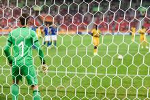 Net In Soccer Goal With Goalke...
