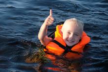 Happy Blond Little Girl Swimmi...
