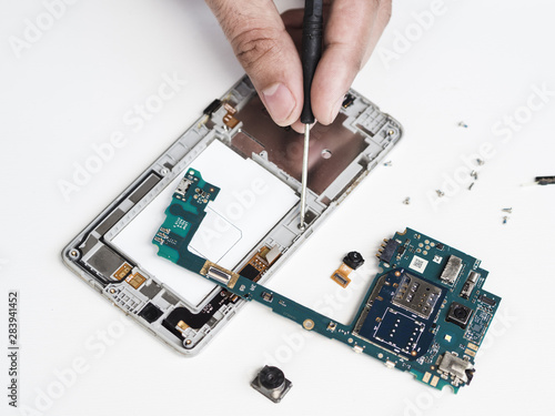 Vászonkép Disassembling a defective phone for repair