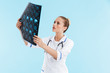 canvas print picture - Beautiful blonde woman doctor wearing uniform standing