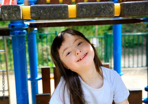 Fotografie, Obraz  Portrait of little girl smiling in the park