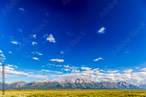 Foto op Plexiglas Donkerblauw Panorama of Mountain Range and Plains, Clouds