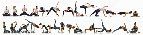 Fototapeta Sporty young woman doing yoga practice on white studio background
