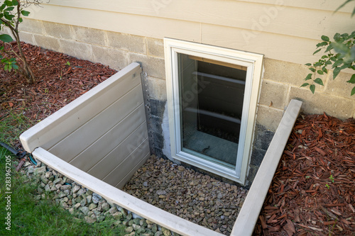 Photo Exterior view of an egress window in a basement bedroom