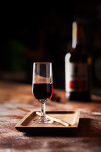 Glass Of Port Wine On Wooden T...