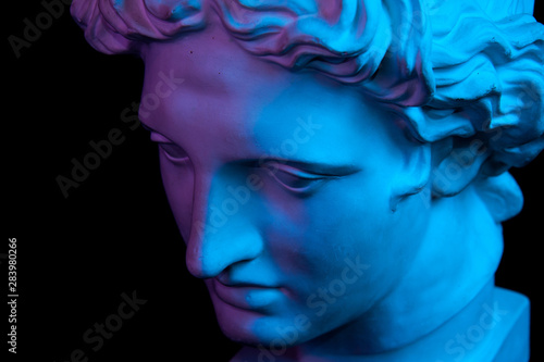 Obraz Gypsum copy of ancient statue Apollo head isolated on black background. Plaster sculpture man face. - fototapety do salonu