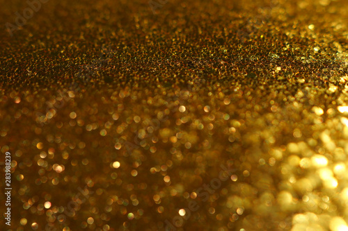 Foto auf AluDibond Artist KB background of abstract glitter lights. gold and black. de-focused