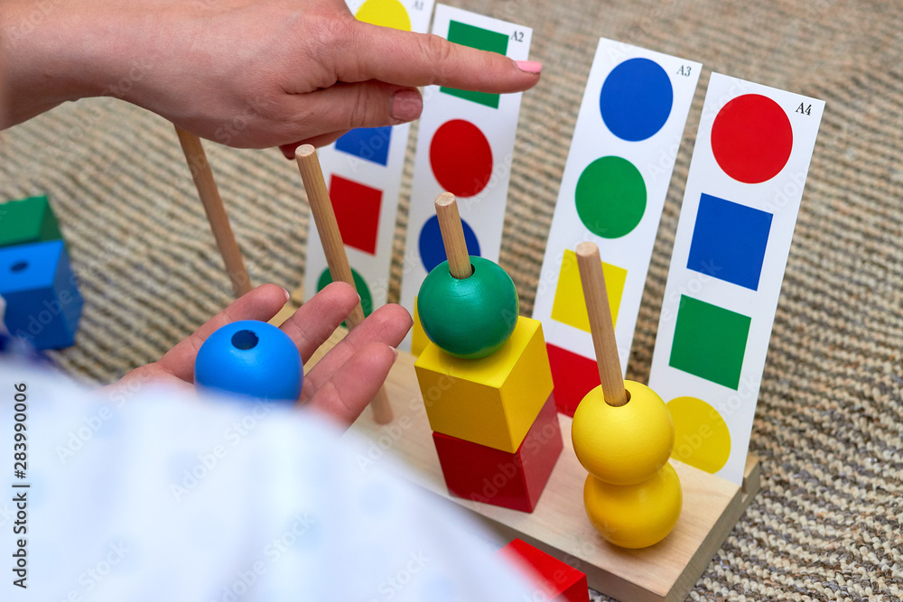 Fototapety, obrazy: Children with moms playing on the floor. Educational games for kids