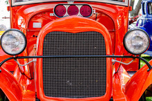 Front View Of A Red Hot Rod