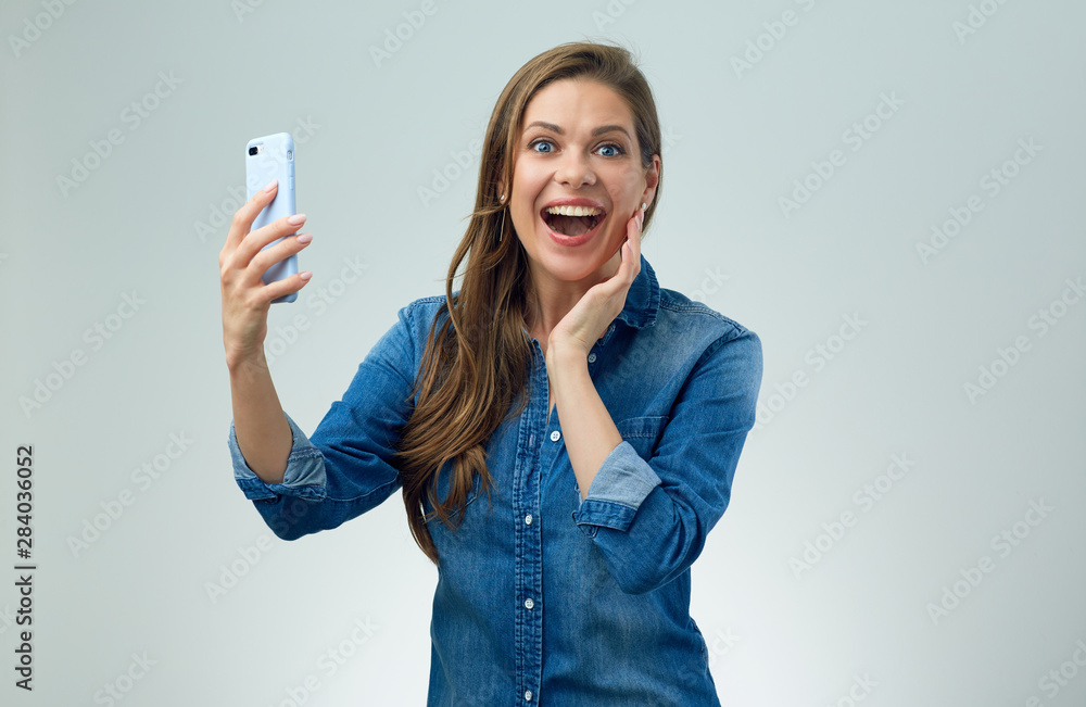 Fototapety, obrazy: Happy woman doing selfie with smart phone.