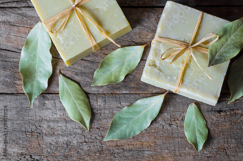 Fotografie, Obraz Organic natural handmade bay laurel soap with olive oil and leaves on wooden rus