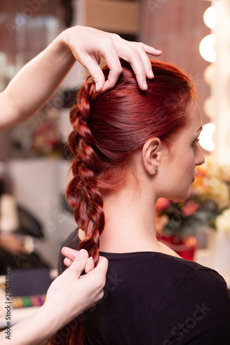 Beautiful Red Haired Girl With Long Hair Hairdresser Weaves A French Braid In A Beauty Salon Professional Hair Care And Creating Hairstyles Buy This Stock Photo And Explore Similar Images At Adobe