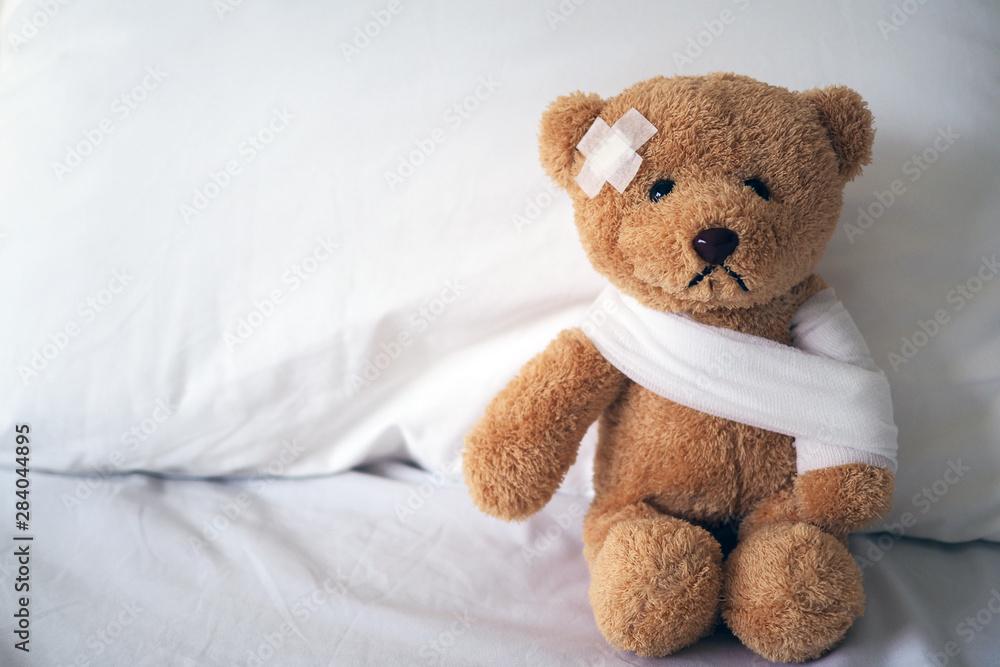 Fototapety, obrazy: Teddy bear and bandage. Injury concept