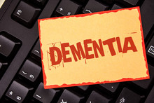Word Writing Text Dementia. Business Concept For Long Term Memory Loss Sign And Symptoms Made Me Retire Sooner Written Sticky Note Paper Placed Black Keyboard. Top View.