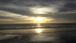 Calm waves flowing towards frame at Sunset on desert beach DOLLY FORWARD, sunlight reflect on water surface with nobody