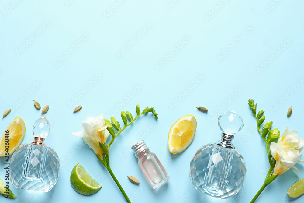 Fototapety, obrazy: Flat lay composition with elegant perfumes on light blue background, space for text