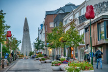 REYKJAVIK, ICELAND - AUGUST 11, 2019: City Street With Cathedral On The Background. The City Hosts Most Of The Island Population
