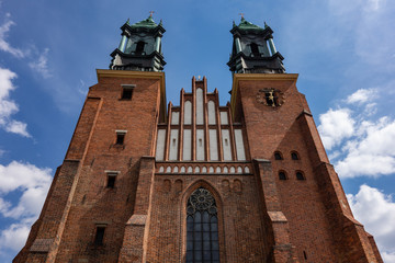 The red brick building of Cathedral of Saint Peter and Paul (Bazylika Archikatedralna pw. sw. Apostolow Piotra i Pawla) in Poznan