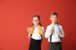 canvas print picture - Little pupils on color background