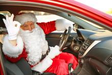 Santa Claus Showing OK Gesture While Driving Car