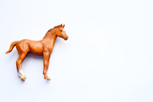 Figurine Of A Horse On White Background