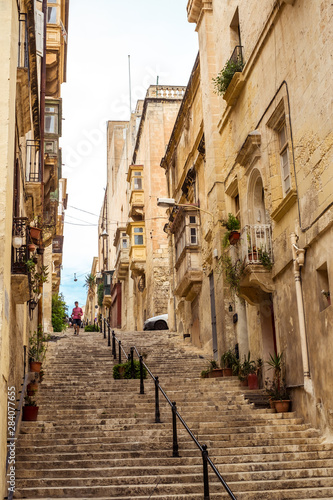 Fototapety, obrazy: street with traditional balconies and old buildings in historical city Valletta Malta