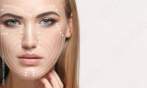 Fotografie, Obraz  Beautiful female face isolated on grey background