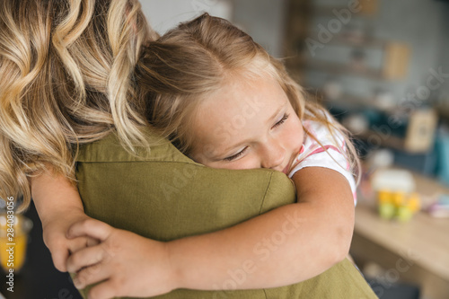Fotografiet Warmth of loving mothers embrace stock photo