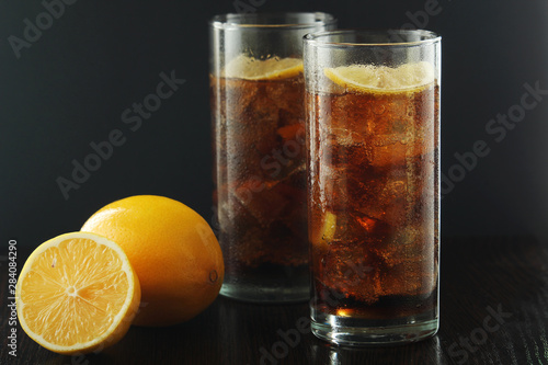 Glasses with cuba libre cocktail or cola with ice or cold tea with lemon Wallpaper Mural