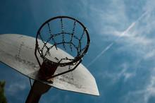 Metal Basketball Hoop Against Blue Cloudy Sky