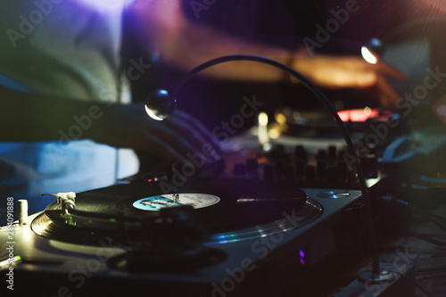 Disc jockey in action during 80's vintage party - 284091888