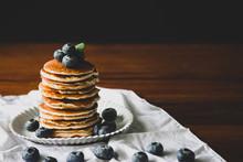 Blueberry Homemade Pancake With Sweet Honey On Wood Table. Horizontal Photos