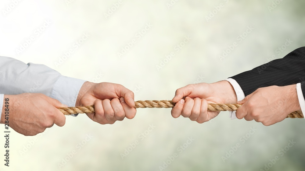 Fototapety, obrazy: Business men hands holding rope on grey background