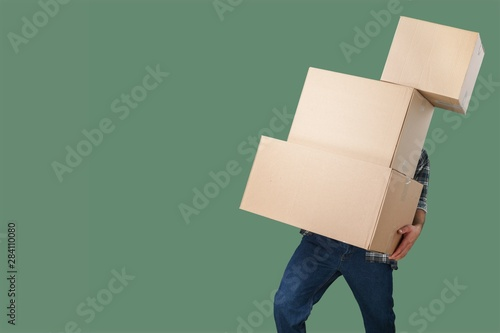 Carrying man stack boxes delivery background copy Canvas Print