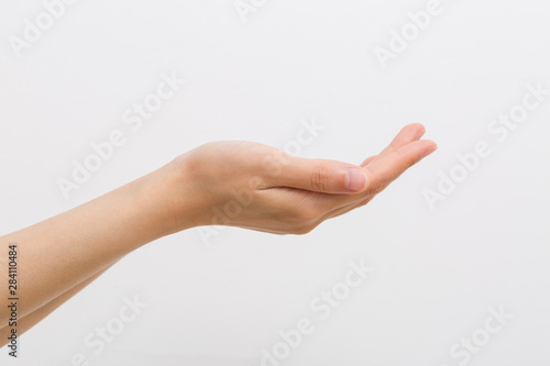 Fototapeta  Outstretched cupped hands of young woman