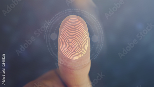 Fototapeta Businessman login with fingerprint scanning technology. fingerprint to identify personal, security system concept obraz