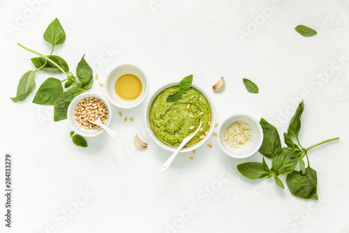 Fototapeta Pesto sauce and ingredients on white background, view from above obraz