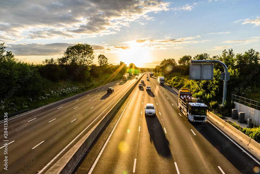 Fototapety, obrazy: busy traffic on uk motorway road overhead view at sunset