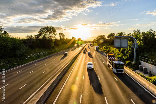 busy traffic on uk motorway road overhead view at sunset Wallpaper Mural
