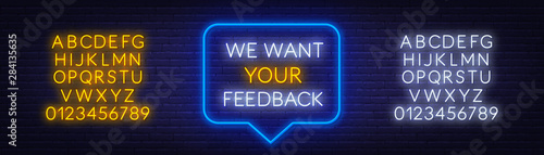 Fototapeta Neon message we want your feedback on a dark background