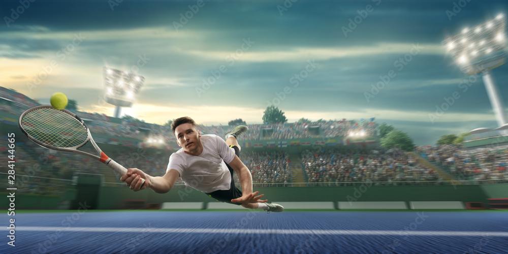 Fototapeta Male athlete plays tennis on a professional court