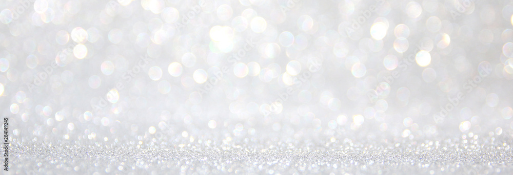 Fototapeta background of abstract glitter lights. silver and white. de-focused