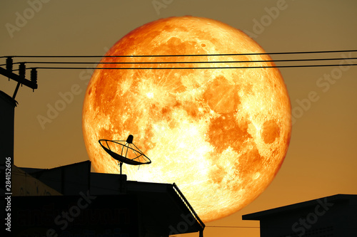 super full harvest blood moon on night sky back satellite dish on the roof Canvas Print