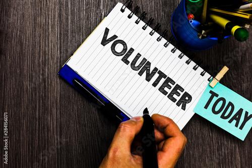 Valokuva Text sign showing Volunteer