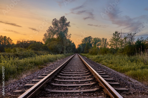 Pinturas sobre lienzo  Train tracks infront of nature and the sunset