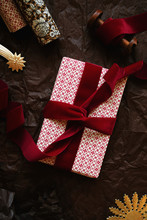 Wrapping A Christmas Gift With Velvet Ribbon And Vintage Golden Metal Decorations