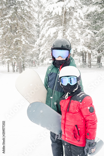 two boys with snowboards