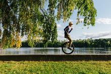 Man Riding Unicycle