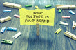 Leinwanddruck Bild - Handwriting text Your Culture Is Your Brand. Concept meaning Knowledge Experiences are a presentation card Paperclip hold written torn page many clips laid on bluish wooden floor